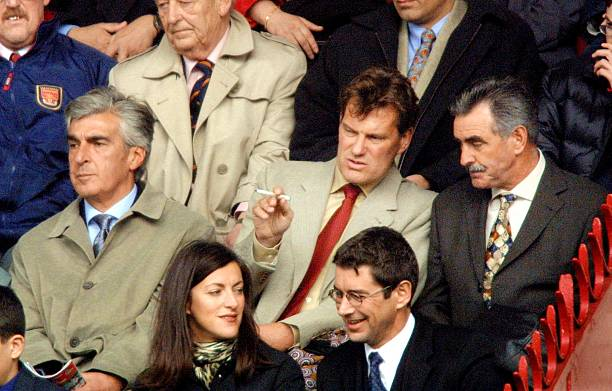 LONDON, UNITED KINGDOM:  Football manager Glenn Hoddle (C) and his long-time assistant John Gorman (R) and ex-Tottenham chairman, Irving Scholar (L), watch Arsenal play Tottenham at Highbury in London 31 March 2001. Hoddle is to take over the role of manager of Tottenham next week after leaving Southampton. Arsenal won the game 2-0 over their north London rivals. (Photo credit ADRIAN DENNIS/AFP via Getty Images)