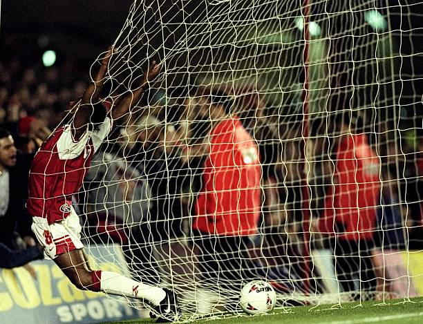 4 Dec 1996: Ian Wright of Arsenal runs into the back of the net during an FA Carling Premiership match against Southampton at Highbury in London. Arsenal won the match 3-1. Mandatory Credit: Mark Thompson/Allsport
