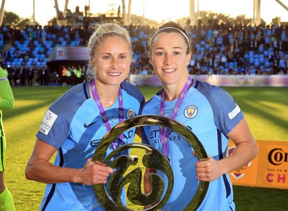 MANCHESTER, ENGLAND - OCTOBER 02: Steph Houghton (L) captain of Manchester City Women lifts the trophy and celebrates with her team-mate Lucy Bronze after winning the Continental Cup Final between Manchester City Women and Birmingham City Ladies at The Academy Stadium on October 2, 2016 in Manchester, England. (Photo by Clint Hughes/Getty Images)