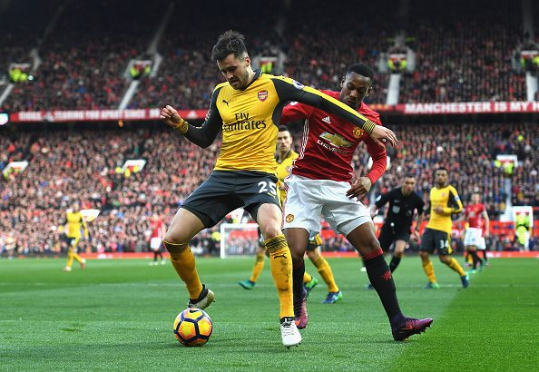 MANCHESTER, ENGLAND - NOVEMBER 19: Carl Jenkinson of Arsenal (L) is put under pressure from Anthony Martial of Manchester United (R) during the Premier League match between Manchester United and Arsenal at Old Trafford on November 19, 2016 in Manchester, England. (Photo by Shaun Botterill/Getty Images)