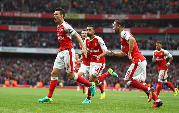 LONDON, ENGLAND - SEPTEMBER 10: Laurent Koscielny of Arsenal celebrates scoring his sides first goal with his Arsenal team mates during the Premier League match between Arsenal and Southampton at Emirates Stadium on September 10, 2016 in London, England. (Photo by Paul Gilham/Getty Images)