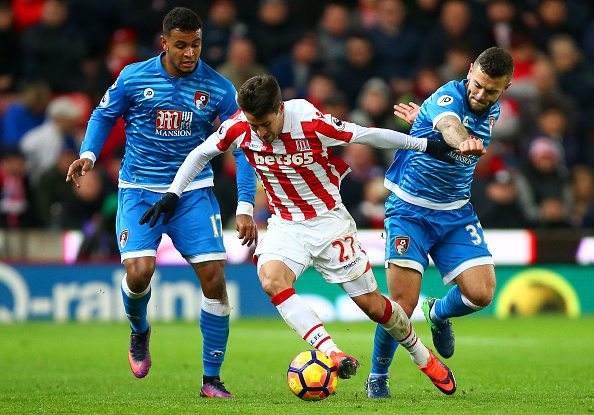 STOKE ON TRENT, ENGLAND - NOVEMBER 19: As well as he is on the ball, Wilshere (far right) has improved his level of tenacity out of possession to win the ball back quickly. (Photo source: Dave Thompson / Getty Images)