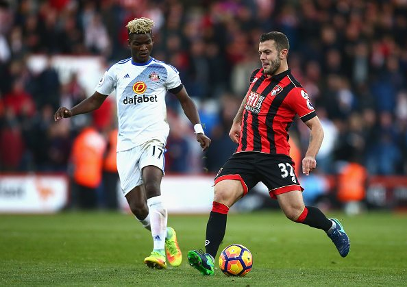 BOURNEMOUTH, ENGLAND - NOVEMBER 05: Jack Wilshere of AFC Bournemouth (R) passes the ball past Dider Ndong of Sunderland (L) during the Premier League match between AFC Bournemouth and Sunderland at Vitality Stadium on November 5, 2016 in Bournemouth, England. (Photo by Jordan Mansfield/Getty Images)