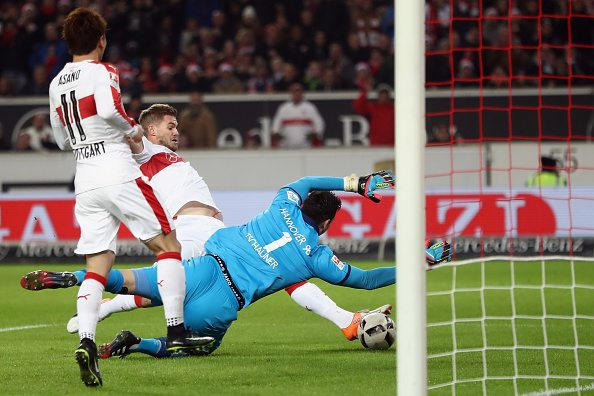 STUTTGART, GERMANY - DECEMBER 12: Simon Terodde of Stuttgart scores his team's first goal against goalkeeper Philipp Tschauner of Hannover during the Second Bundesliga match between VfB Stuttgart and Hannover 96 at Mercedes-Benz Arena on December 12, 2016 in Stuttgart, Germany. (Photo by Alex Grimm/Bongarts/Getty Images)