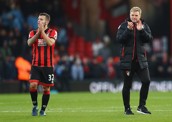 BOURNEMOUTH, ENGLAND - DECEMBER 04: Eddie Howe manager of AFC Bournemouth celebrates victory with Jack Wilshere of AFC Bournemouth after the Premier League match between AFC Bournemouth and Liverpool at Vitality Stadium on December 4, 2016 in Bournemouth, England.