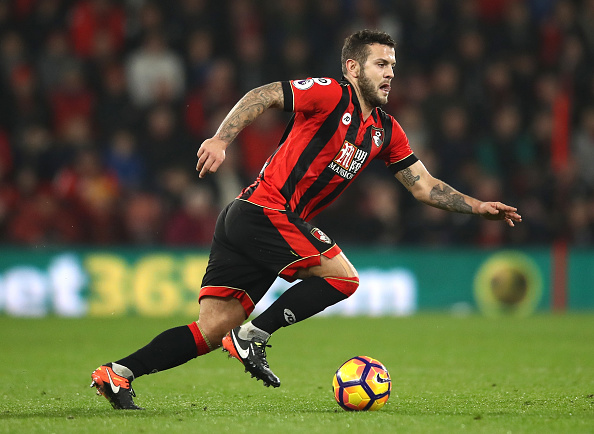Jack Wilshere dribbles with the ball at his feet during the Premier League match between AFC Bournemouth and Leicester City at the Vitality Stadium on December 13, 2016 in Bournemouth, England.