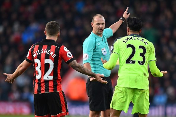 Referee Bobby Madley (C) speaks with Bournemouth's English midfielder Jack Wilshere (L) and Liverpool's German midfielder Emre Can during the English Premier League football match between Bournemouth and Liverpool at the Vitality Stadium in Bournemouth, southern England on December 4, 2016. / AFP / Glyn KIRK / RESTRICTED TO EDITORIAL USE. No use with unauthorized audio, video, data, fixture lists, club/league logos or 'live' services. Online in-match use limited to 75 images, no video emulation. No use in betting, games or single club/league/player publications. / (Photo credit should read GLYN KIRK/AFP/Getty Images)