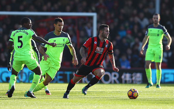 BOURNEMOUTH, ENGLAND - DECEMBER 04: Jack Wilshere of AFC Bournemouth evades Georginio Wijnaldum and Dejan Lovren of Liverpool during the Premier League match between AFC Bournemouth and Liverpool at Vitality Stadium on December 4, 2016 in Bournemouth, England. (Photo by Michael Steele/Getty Images)