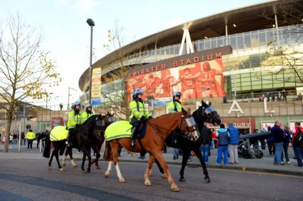LONDON, ENGLAND - DECEMBER 08: Mounted police ride past the stadium ahead of the Barclays Premier League match between Arsenal and Everton at Emirates Stadium on December 8, 2013 in London, England. (Photo by Michael Regan/Getty Images)