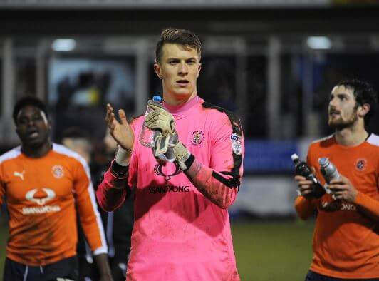 Macey applauds the home supporters after Luton's 2-1 win