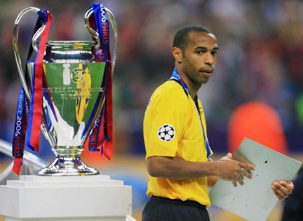 Saint-Denis, FRANCE: Arsenal's French forward and team captain Thierry Henry passes next to the trophy after the UEFA Champion's League final football match Barcelona vs. Arsenal, 17 May 2006 at the Stade de France in Saint-Denis, northern Paris. Barcelona won 2 to 1. AFP PHOTO ODD ANDERSEN