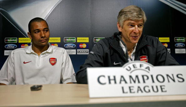 Valencia, SPAIN:  Arsenal's Gilberto (L) and manager Arsene Wenger are seen at a press conference at the Madrigal stadium in Villarreal ahead of their Champions League semi-final second leg match against Villarreal, 24 April 2006. Arsenal enter the tie with a 1-0 win at home from the first leg. AFP PHOTO/CARL DE SOUZA.