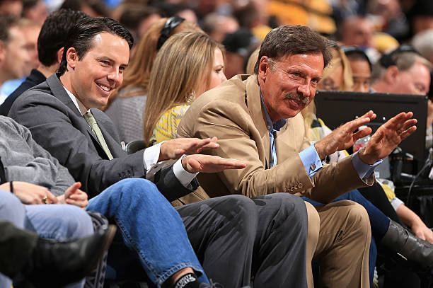 DENVER, CO - APRIL 20: (L-R) Denver Nuggets President Josh Kroenke and his father Stan Kroenke, the owner of the Denver Nuggets offer praise for Rocky, the team mascot, as they watch the game from courtside seats as the Nuggets face the Golden State Warriors during Game One of the Western Conference Quarterfinals of the 2013 NBA Playoffs at the Pepsi Center on April 20, 2013 in Denver, Colorado. The Nuggets defeated the Warriors  (Photo by Doug Pensinger/Getty Images)