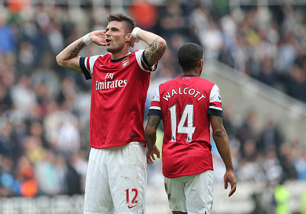 Arsenal's French striker Olivier Giroud (L) and Arsenal's English midfielder Theo Walcott (R) celebrate their victory after the final whistle in the English Premier League football match between Newcastle United and Arsenal at St James' Park in Newcastle Upon Tyne, northeast England, on May 19, 2013 (Ian MacNicol/AFP/Getty Images)
