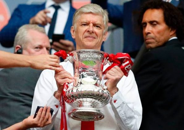 Arsenal's French manager Arsene Wenger smiles as he holds the FA Cup trophy after their win over Chelsea in the English FA Cup final football match between Arsenal and Chelsea at Wembley stadium in London on May 27, 2017. (ADRIAN DENNIS/AFP/Getty Images)