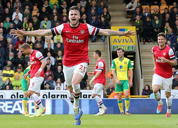 Arsenal's English defender Carl Jenkinson celebrates scoring their second goal during the English Premier League football match between Norwich City and Arsenal at Carrow Road in Norwich on May 11, 2014. (LINDSEY PARNABY/AFP/Getty Images)
