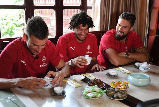 Laurent Koscielny Olivier Giroud and Mohamed Elneny laughing