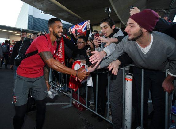 Theo Walcott greets fan