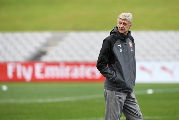 Wenger looks on