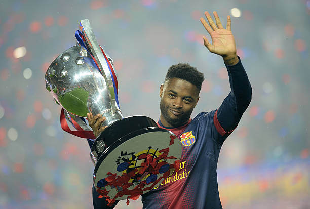 Barcelona's Cameroonian midfielder Alex Song celebrates during a ceremony at the Camp Nou stadium in Barcelona on May 19, 2013 after winning the Spanish League title. Barcelona celebrated lifting the La Liga trophy for a 22nd time with a 2-1 win over Valladolid. (LLUIS GENE/AFP/Getty Images)