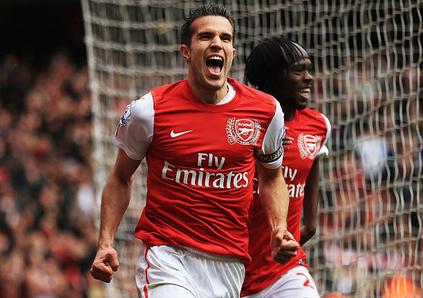 LONDON, ENGLAND - MAY 05: Robin van Persie of Arsenal celebrates scoring their third goal during the Barclays Premier League match between Arsenal and Norwich City at the Emirates Stadium on May 5, 2012 in London, England. (Photo by Bryn Lennon/Getty Images)