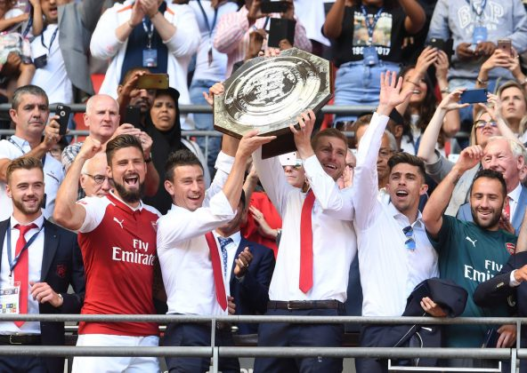 LONDON, ENGLAND - AUGUST 06: (L-R) Calum Chambers, Olivier Giroud, Laurent Koscielny, Per Mertesacker, Gabriel and David Ospina of Arsenal lift the Community Shield after the match between Chelsea and Arsenal at Wembley Stadium on August 6, 2017 in London, England. (Photo by David Price/Arsenal FC via Getty Images)