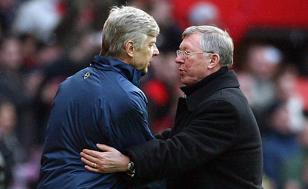 Manchester United manager Sir Alex Ferguson (R) shakes hands with Arsenal manager Arsene Wenger after their English Premier League football match at Old Trafford in Manchester, north west England on April 13, 2008. United won the game 2-1. (PAUL ELLIS/AFP/Getty Images)