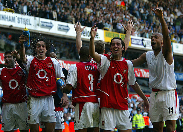 Arsenal undefeated: LONDON, UNITED KINGDOM: Arsenal's L to R facing camera Jose Antonio Reyes,Robert Pires,Edu and Thierry Henry celebrates winning the 2003/2004 Football Premier League after drawing 2-2 with Tottenham during their Premier League clash at White Hart Lane in north London, 25 April 2004. AFP PHOTO / ODD ANDERSEN