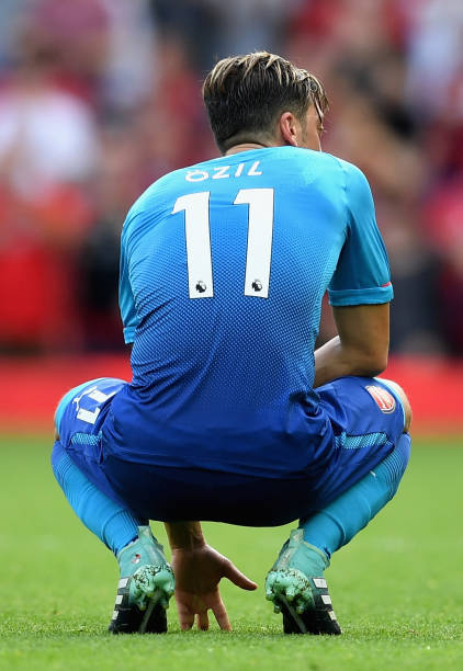 LIVERPOOL, ENGLAND - AUGUST 27: Mesut Ozil of Arsenal is dejected after the Premier League match between Liverpool and Arsenal at Anfield on August 27, 2017 in Liverpool, England. (Photo by Michael Regan/Getty Images)