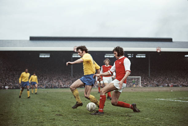 LONDON, UNITED KINGDOM - APRIL 20: Arsenal player Peter Simpson (r) is challenged by Kevin Hector of Derby during a First Divsion match between Arsenal and Derby County at Highbury on April 20, 1974 in London, England. (Photo by Don Morley/Allsport/Getty Images)