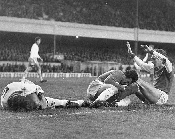 10th January 1976: Players on the ground after a goalmouth collision during a match between Arsenal and Aston Villa at Highbury. Chris Nicholl of Aston Villa is on the left, beside goalkeeper John Burridge and Sammy Nelson of Arsenal. (Photo by Dennis Oulds/Central Press/Getty Images)