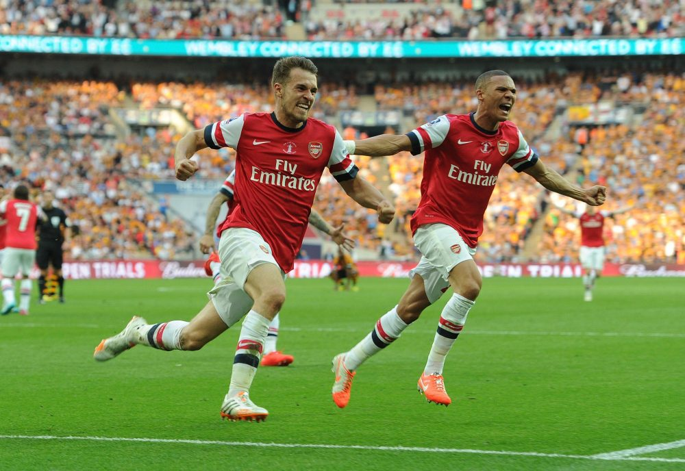 LONDON, ENGLAND - MAY 17:  Aaron Ramsey celebrates scoring Arsenal's 3rd goal with Kieran Gibbs during the match between Arsenal and Hull City in the FA Cup Final at Wembley Stadium on May 17, 2014 in London, England.  (Photo by David Price/Arsenal FC via Getty Images) *** Local Caption *** Aaron Ramsey; Kieran Gibbs