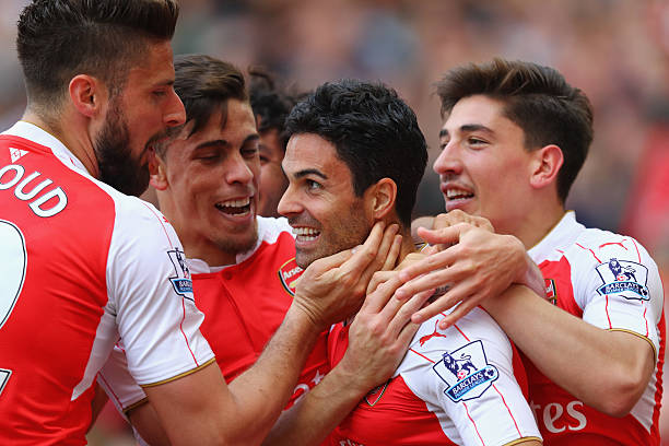 LONDON, ENGLAND - MAY 15: Mikel Arteta of Arsenal is congratulated by team mates after scoring to make it 4-0 during the Barclays Premier League match between Arsenal and Aston Villa at the Emirates Stadium on May 15, 2016 in London, England. (Photo by Julian Finney/Getty Images)