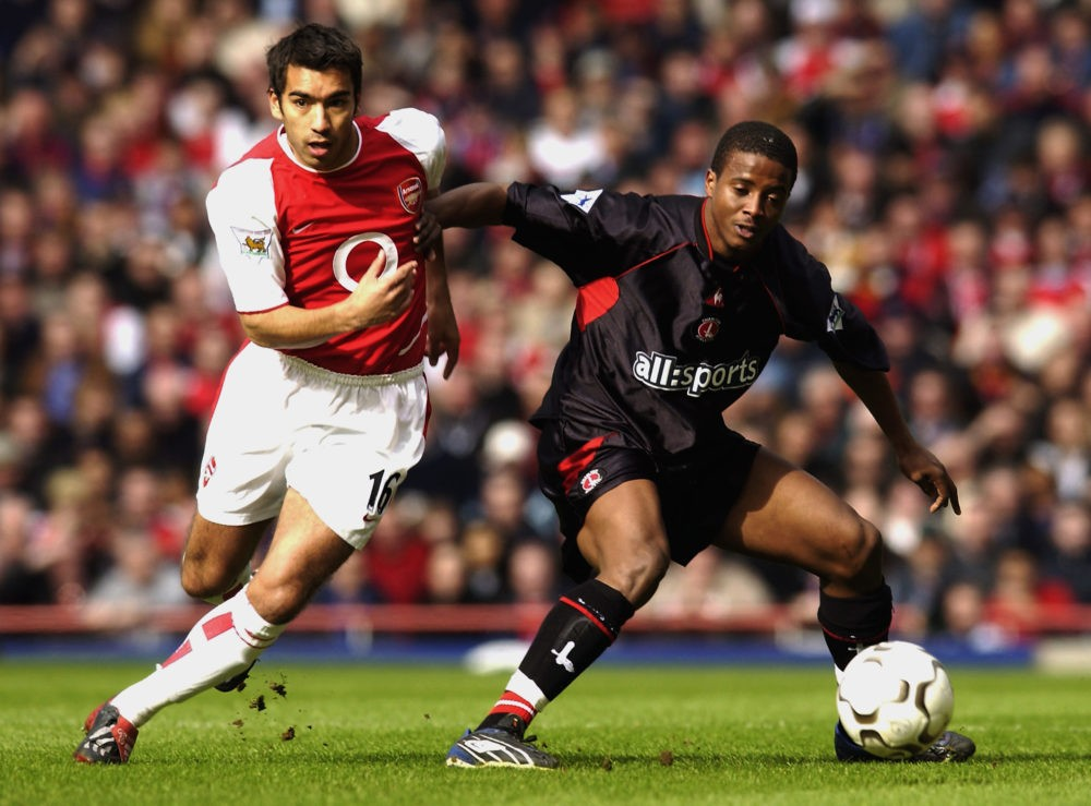 LONDON - MARCH 2: Kevin Lisbie of Charlton Athletic shields the ball from Giovanni van Bronckhorst of Arsenal during the FA Barclaycard Premiership match held on March 2, 2003 at Highbury, in London. Arsenal won the match 2-0. (Photo by Jamie McDonald/Getty Images)