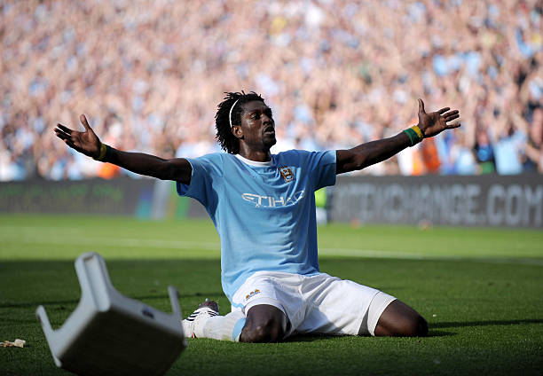 MANCHESTER, ENGLAND - SEPTEMBER 12: Emmanuel Adebayor of Manchester City celebrates in front of the Arsenal fans after scoring during the Barclays Premier League match between Manchester City and Arsenal at the City of Manchester Stadium on September 12, 2009 in Manchester, England. (Photo by Shaun Botterill/Getty Images)