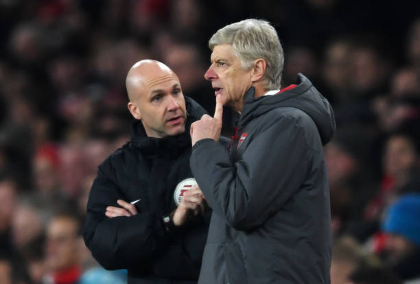 Arsene Wenger, with a finger to his chin, ponders what fourth official Anthony Taylor is saying during the Premier League match between Arsenal and Manchester United at Emirates Stadium on December 2, 2017 in London, England. (Photo by Laurence Griffiths/Getty Images)