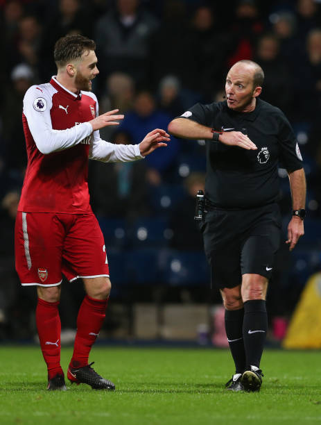 WEST BROMWICH, ENGLAND - DECEMBER 31: Calum Chambers of Arsenal appeals as referee Mike Dean awards a penalty against him during the Premier League match between West Bromwich Albion and Arsenal at The Hawthorns on December 31, 2017 in West Bromwich, England. (Photo by Jan Kruger/Getty Images)