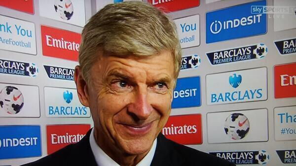 Wenger's face during a post-match interview before Arsenal signed Mesut Ozil in 2013