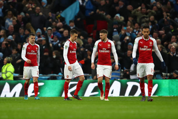 LONDON, ENGLAND - FEBRUARY 25: Granit Xhaka, Laurent Koscielny, Aaron Ramsey and Pierre-Emerick Aubameyang of Arsenal look dejected during the Carabao Cup Final between Arsenal and Manchester City at Wembley Stadium on February 25, 2018 in London, England. (Photo by Julian Finney/Getty Images)