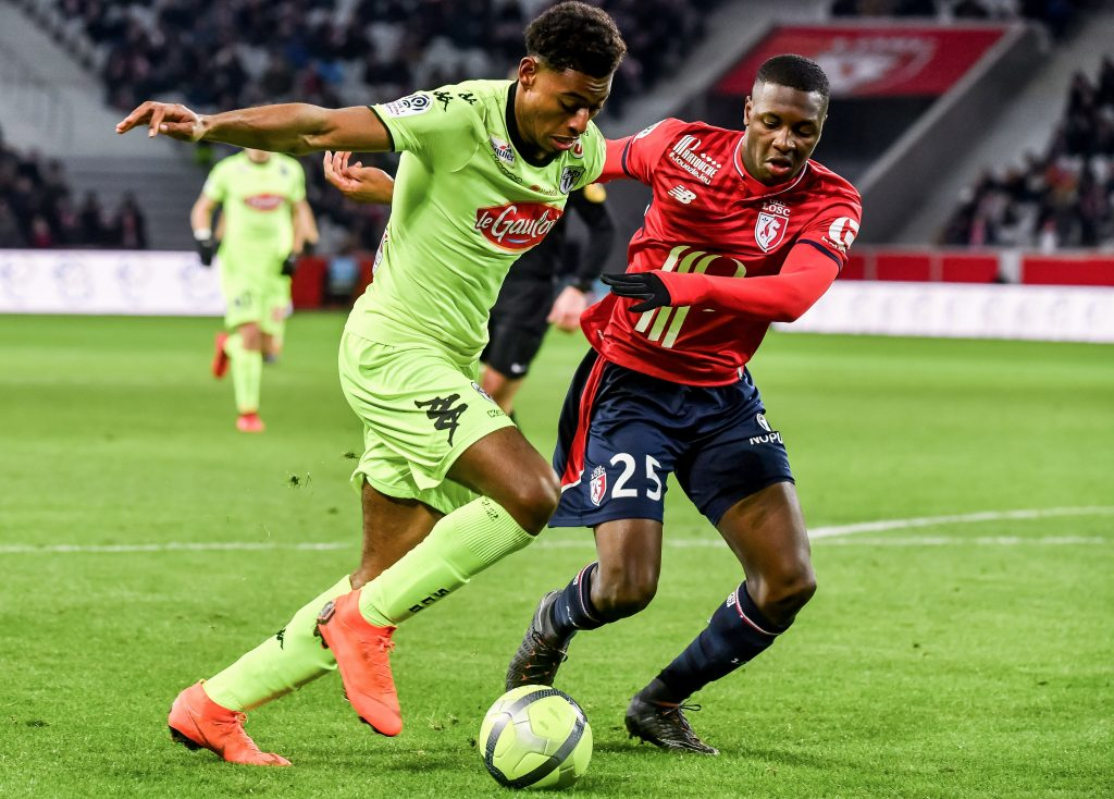 Lille's French defender Fode Ballo-Toure (R) vies with Angers' French midfielder Jeff Reine Adelaide during the French L1 football match Lille vs Angers on February 24 2018 at the Pierre Mauroy stadium in Villeneuve d'Ascq, northern france. ( / AFP PHOTO / PHILIPPE HUGUEN / Getty Images)
