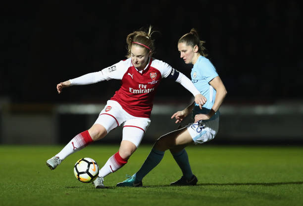 HIGH WYCOMBE, ENGLAND - MARCH 14: Kim Little of Arsenal is challenged by Abbie McManus of Manchester City during the WSL Continental Cup Final between Arsenal Women and Manchester City Ladies at Adams Park on March 14, 2018 in High Wycombe, England. (Photo by Catherine Ivill/Getty Images)