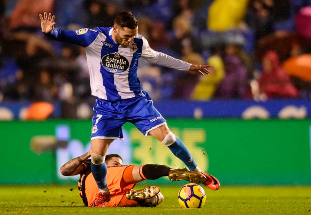 Deportivo La Coruna's Spanish forward Lucas Perez (top) vies with Valencia's Spanish forward Santi Mina during the Spanish league football match between RC Deportivo de la Coruna and Valencia CF at the Municipal de Riazor stadium in La Coruna on January 13, 2018. (MIGUEL RIOPA/AFP/Getty Images)