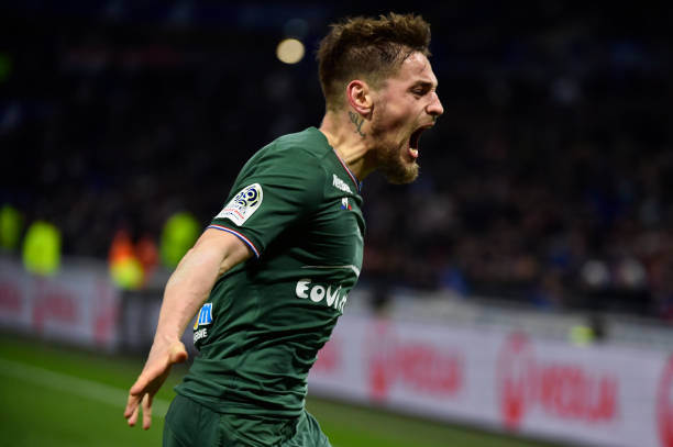 Saint-Etienne's French defender Mathieu Debuchy celebrates after scoring a goal during the French L1 football match between Lyon (OL) and Saint-Etienne (ASSE) on February 25, 2018, at the Groupama stadium in Decines-Charpieu near Lyon, central-eastern France. / AFP PHOTO / ROMAIN LAFABREGUE