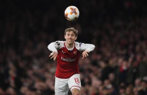 LONDON, ENGLAND - MARCH 15: Nacho Monreal of Arsenal takes a throw in during the UEFA Europa League Round of 16 second leg match between Arsenal and AC Milan at Emirates Stadium on March 15, 2018 in London, England. (Photo by Shaun Botterill/Getty Images)