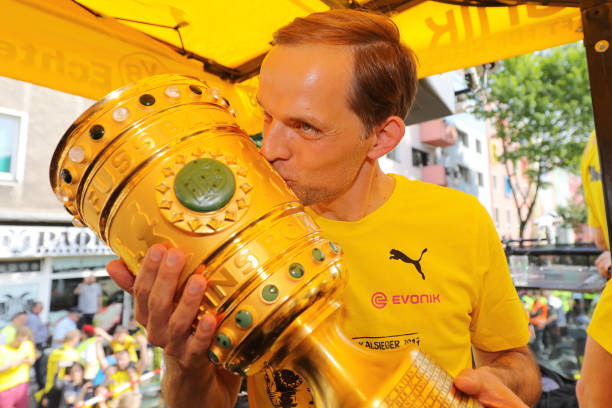 DORTMUND, GERMANY - MAY 28: Trainer Thomas Tuchel of Borussia Dortmund lifts the DFB Cup trophy as the team celebrates during a winner's parade at Borsigplatz on May 28, 2017 in Dortmund, Germany. (Photo by Pool - Getty Images)