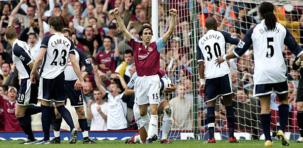 LONDON, UNITED KINGDOM: West Ham goal scorer Yossi Benayoun celebrates, surrounded by Tottenham players, during their Premiership football match against Tottenham, at home to West Ham, 07 May 2006. The match ended 2-1 to West Ham. AFP PHOTO/CARL DE SOUZA.