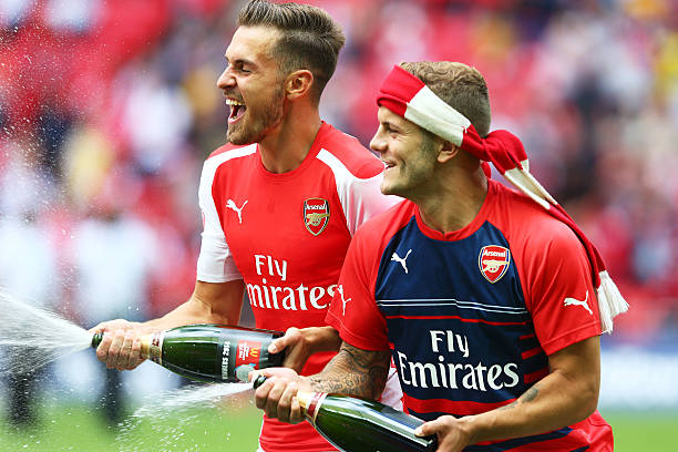 LONDON, ENGLAND - AUGUST 10: Aaron Ramsey and Jack Wilshere of Arsenal celebrate their win during the FA Community Shield match between Manchester City and Arsenal at Wembley Stadium on August 10, 2014 in London, England. (Photo by Clive Mason/Getty Images)