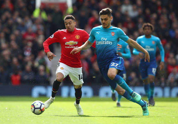 MANCHESTER, ENGLAND - APRIL 29: Konstantinos Mavropanos of Arsenal is challenged by Jesse Lingard of Manchester United during the Premier League match between Manchester United and Arsenal at Old Trafford on April 29, 2018 in Manchester, England. (Photo by Clive Brunskill/Getty Images)