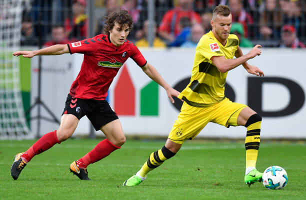 Freiburg's Turkish defender Caglar Soyuncu (L) and Dortmund's Ukrainian forward Andrey Yarmolenko vie for the ball during German first division Bundesliga football match between SC Freiburg and Borussia Dortmund on September 9, 2017 in Freiburg, southwestern Germany. / AFP PHOTO / THOMAS KIENZLE