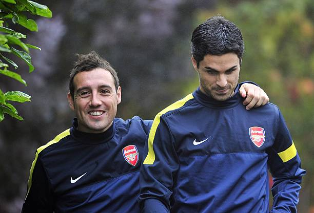 Arsenal's Spanish midfielder Santi Cazorla (L) and Spanish midfielder Mikel Arteta (R) attend training for the forthcoming UEFA Champions League group B football match against FC Schalke 04 at Arsenal's training ground, London Colney, North London, England on October 23, 2012. AFP PHOTO/GLYN KIRK